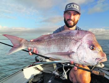 Josh King with an 80cm snapper on light spin gear.