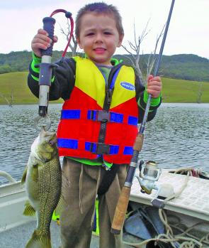 Dominic Buechner, 4, caught his first bass at Lake St Clair. The 32cm fish took a cast Squidgy Bug.