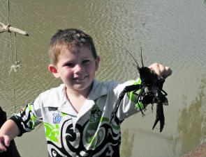Youngster Darcy Raisbeck had a ball catching red claw recently.