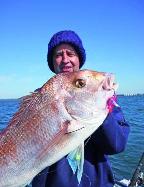 John Graham displays a magnificent snapper that he caught after a day of very hard work finding feeding fish.