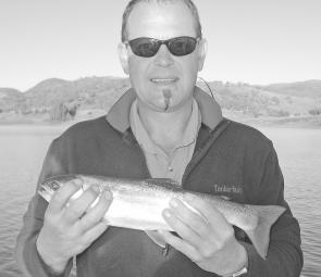 Quartus Reyneke of Merimbula with a 700g rainbow off the downrigger at 10m.
