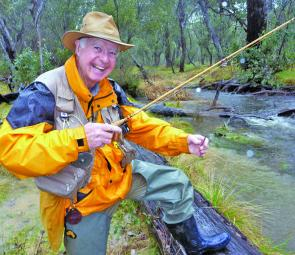 Peter Campbell has put a worm on his fly in a desperate attempt to catch a trout in the Buemba River on opening morning.