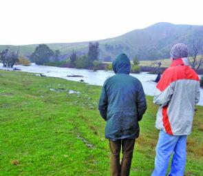 Adrian Bond (L) and Colin Bellfield (R) look mournfully up the Mitta Mitta River on opening morning. They were hoping for a miracle but it did not come. At this time the Mitta was about twice its normal size. Just a few hours later it was double this size