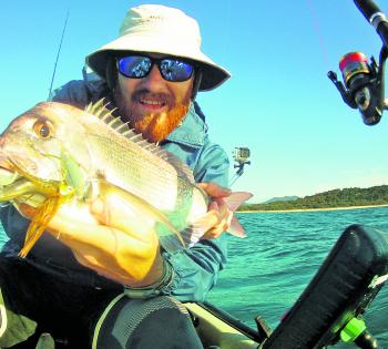 The author putting the trusty spinnerbaits through some hard work in the salt on shallow water snappers.