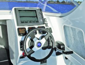 The helm is well set out and all controls fall to hand nicely. Check out the huge colour sounder display.
