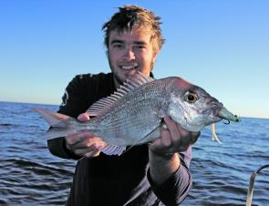 The author with a snapper taken on plastics offshore. This is what anglers are waiting for in May.