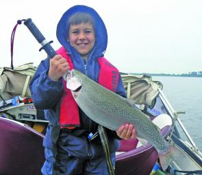 Curtis with his biggest rainbow trout to date, caught at Lake Bolac.