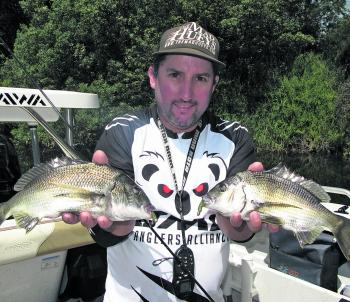 Bryan Lazzaro with two bream caught during a mind-blowing lure session on the Mitchell River.