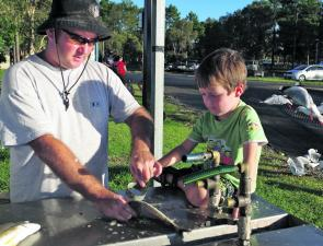 Russell Farley and young Luca clean some of the quality bream they caught at the new Evans Head boat ramp.