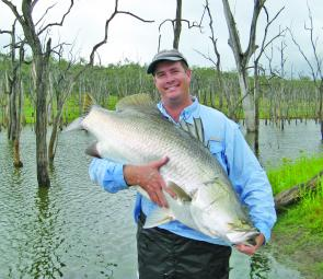 Scott McAuley cuddling the Monduran Big Barra of 114cm.