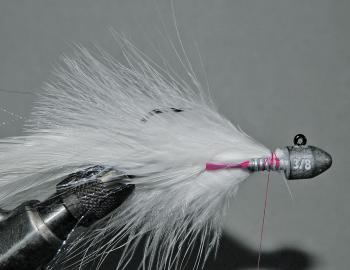 Next, do the same on top of the hook shank to secure a similar amount of marabou quills.
