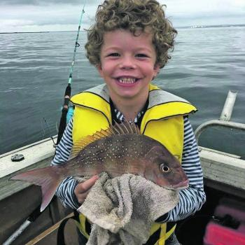 Murphy Johnson and his first ever snapper!