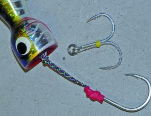 A completed head hook and a belly hook ready top go onto a large popper.