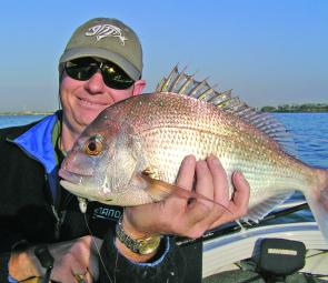 Steve with a nice pan-sized snapper from the river mouth.