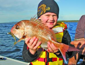 They're never too young to learn lure fishing. The author's nephew, Johnny, was over the moon when he caught his first snapper on a plastic.