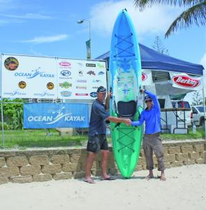 Lindsay presenting Ivan with his new Ocean Kayak Pacific Angler.