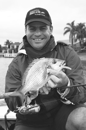 The fruits of some tough conditions. The author with a lovely bream taken while 'pink grubbing' in the rain.