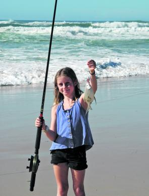 Young Olivia James looks pretty happy with this dart taken up at Teewah.