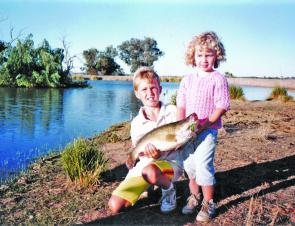 This shot was taken quite a number of years ago now but it shows a young Matthew and Mandy Lennon holding an Oar-Gee caught cod.