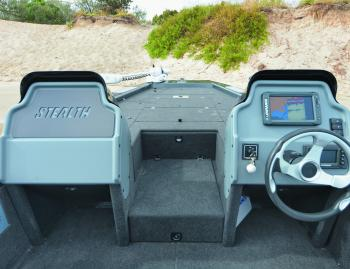When a boat does 80km/h, the passenger console is pretty important. The step between them is the lid for the rod locker.