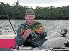 Big redfin are a feature at Brushy Lagoon – Michal Rybka with a typical 1.5kg redfin perch.