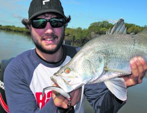 Luke with a Hypo Headz snared barramundi