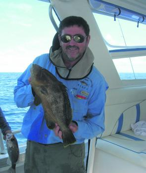 Jeff Sorrell with a small maori cod which couldn't resist a well presented soft plastic.
