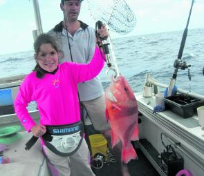 Bella with a solid red caught during a rough day on the water.