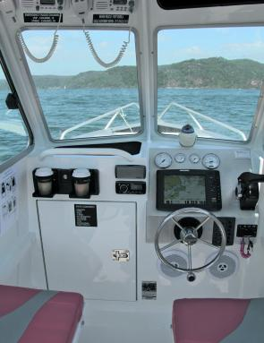 The centre cab is large and fitted with a Humminbird GPS/sounder, GME radios, and a Fusion stereo system.