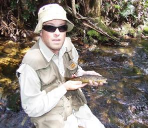 Matt Campbell holds up one of a stack of small brown trout he caught up the Tanjil on dry fly.