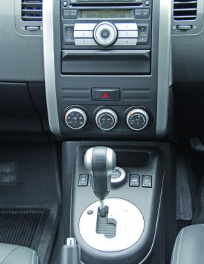 x 4 activation is via the large console mounted knob ahead of the X-Trail's gear selector.