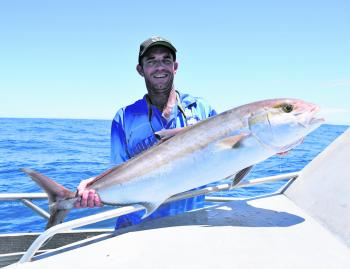 This solid amberjack caught on live bait brought a smile to this angler's face!