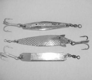 Metal lures make a great alternative to pilchard baits for salmon at this time of year. From top to bottom; Sure Catch Knight, ABU Toby and half-by-quarter