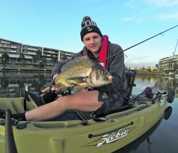 Local lure casting enthusiast, Joel Bramble, with one of many Maribyrnong River bream he's encountered whilst casting Cranka Crabs hard up against floating pontoons.