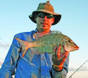 The author with a nice grassy emperor caught on slab bait.