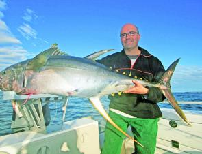 Phil Petridis with 53kg of never-say-die yellowfin tuna taken wide of Batemans Bay.