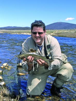Daniel Raffaele with a fast water rainbow from the Eucumbene River.