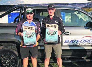 Bayford Volkswagen East Gippsland Bream Classic Champions, Team Colac Tackle's Dan Mackrell and Steve Parker pose with their trophies in front of the awesome VW Amarok.