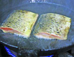 The trout should be cooked flesh side first for presentation.