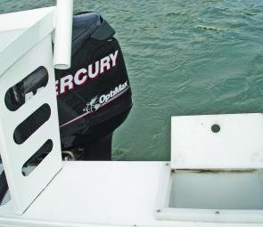 The port side transom top has a good sized fully plumbed live bait tank in an ideal position for easy access.