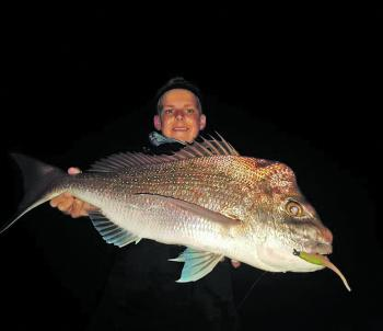 "The snapper are in! Brendan Blackburn caught this solid snapper on a ZMan 5"" Jerk Shad in electric chicken."