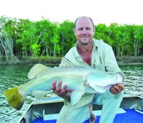 Not all the barra are huge. The author holds up an average sized Cairns Inlet barra taken while casting a B52 up Redbank Creek.