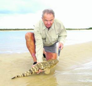 Neil Grimley with a 78cm flathead caught and released in Noosa River mouth.