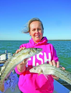 Angie Day tussles with two magnificent whiting from the Middle Spit.