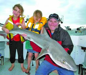 Gawaine Blake and kids Asher and Poppy with Asher's 17kg gummy shark.