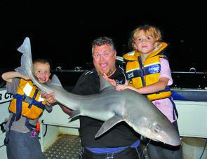 Brendan Wing and kids Billie and Fin with Billie's 17kg Gummy Shark.