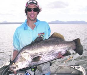 Daniel Grech holds up a hefty barramundi from Peter Faust Dam. This size of fish is possible while trolling this month.