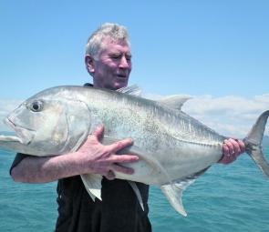 Colin Green holds up the prize at the end of a long fight with one of the toughest fish in the Whitsundays – the GT.