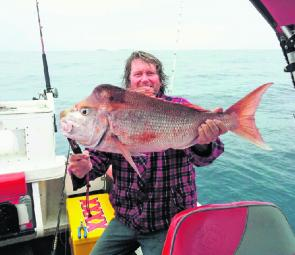 Kent Walker with over 12kg of snapper caught outside the bar.