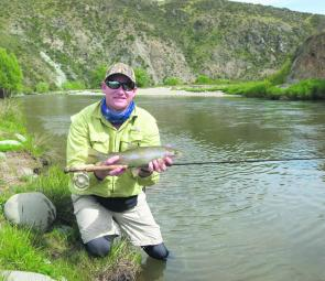 A waist pack, such as the one Scott Kampe is wearing, will hold virtually all of the items needed for a session on New Zealand's trout. Tights and shorts make wading easy too.